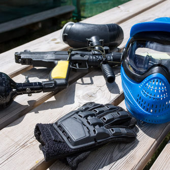 Paintball,Equipment,Placed,On,Wooden,Background